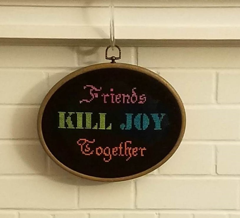 """Needlepoint that reads """"Friends Kill Joy Together"""""""